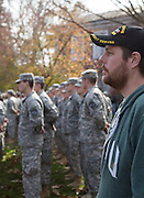 Tyler Daniels, an undergraduate student double majoring in War and Peace Studies and Political Science, listens to the Veterans Day Ceremony on College Green on November 11, 2015. Daniels is a veteran and the president of the Combat Veterans Club at Ohio University. Photo by Emily Matthews