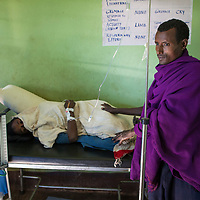 A man waits for a Hamlin midwife to attend to his wife who is suffering obstructed labor at a midwife health post in rural Ethiopia near Bahir Dar
