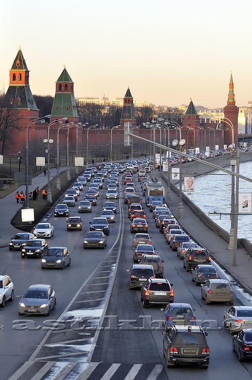 Traffic on Moscow River embankment, Kremlyovskaya naberezhnaya.