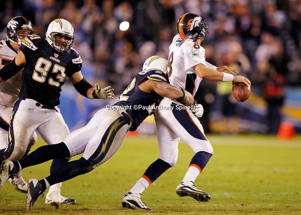 Denver Broncos quarterback Kyle Orton (8) gets sacked by San Diego Chargers linebacker Larry English (52) during the fourth quarter of the NFL week 11 football game against the San Diego Chargers on Monday, November 22, 2010 in San Diego, California. The Chargers won the game 35-14. (©Paul Anthony Spinelli)