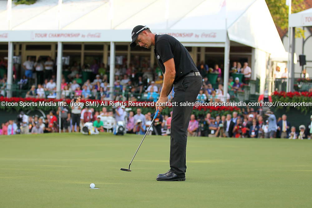 September 22, 2013: Henrik Stenson of Sweden drops his final putt on the 18th to win in the final round of the FedEx Cup - The Tour Championship at East Lake Golf Club in Atlanta, Georgia.