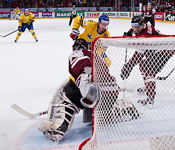 15.05.2012, Ericsson Globe, Stockholm, SWE, IIHF, Eishockey WM, Schweden (SWE) vs Lettland (LVL), im Bild Sverige Sweden 19 Niklas Bäckström, Latvia 1 Goalkeeper Maris Jucers (Dinamo Riga) // during the IIHF Icehockey World Championship Game between Schweden (SWE) vs Latvia (LVL) at the Ericsson Globe, Stockholm, Sweden on 2012/05/15. EXPA Pictures © 2012, PhotoCredit: EXPA/ PicAgency Skycam..***** ATTENTION - OUT OF SWE *****