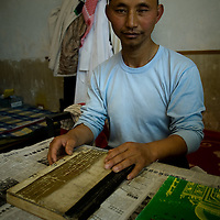 A chinese muslim read the Koran in the  Dujia Tan Mosque before the daily pray  in northwest China's Ningxia Hui Autonomous Region, China, on Thursday, September. 11, 2008. The islam is the second biggest religion in China, where there are between 20 and 30 millions of muslims.