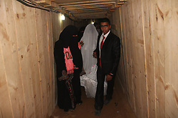 Palestinian man Emad Al-Malalha walks with his Egyptian bride Manal Abu Shanar through a smuggling tunnel in southern Gaza Strip city of Rafah on March 21, 2013. Emad walked with his bride through a smuggling tunnel to celebrate his wedding in Gaza Strip after Egyptian authorities refused to give her a permit, Gaza, on March 21, 2013. Photo by Imago / i-Images...UK ONLY.
