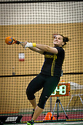 Alexia Child of University of Wisconsin-Oshkosh struggles to make a full turn on her way to winning the Women's Weight Throw on Friday at the NCAA Division III Indoor Track and Field National Championships at Grinnell College.