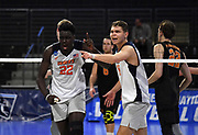 Pepperdine Waves setter Robert Mullahey (18) celebrates with middle blocker Kevin Vaz (22) during an NCAA Championships opening round match againstthe Princeton Tigers, Wednesday, April 30, 2019, in Long Beach, Calif. Pepperdine defeated Princeton 25-23, 19-25, 25-16, 22-25, 15-8.