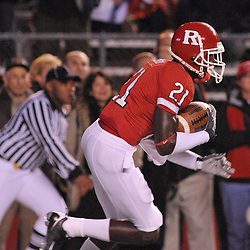 Nov 12, 2009; Piscataway, NJ, USA; Rutgers cornerback Devin Mccourty (21) returns a kickoff during first half NCAA Big East football action between Rutgers and South Florida at  Rutgers Stadium.