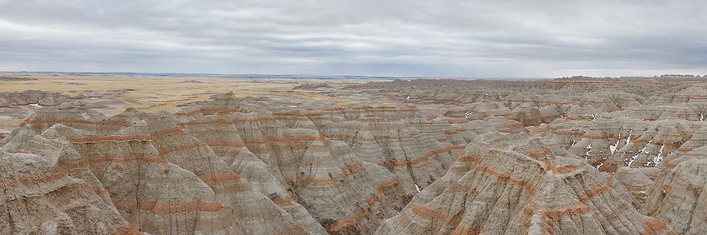 Bands of red soil exposed after rapid soil erosion at the Badlands National Park, South Dakota