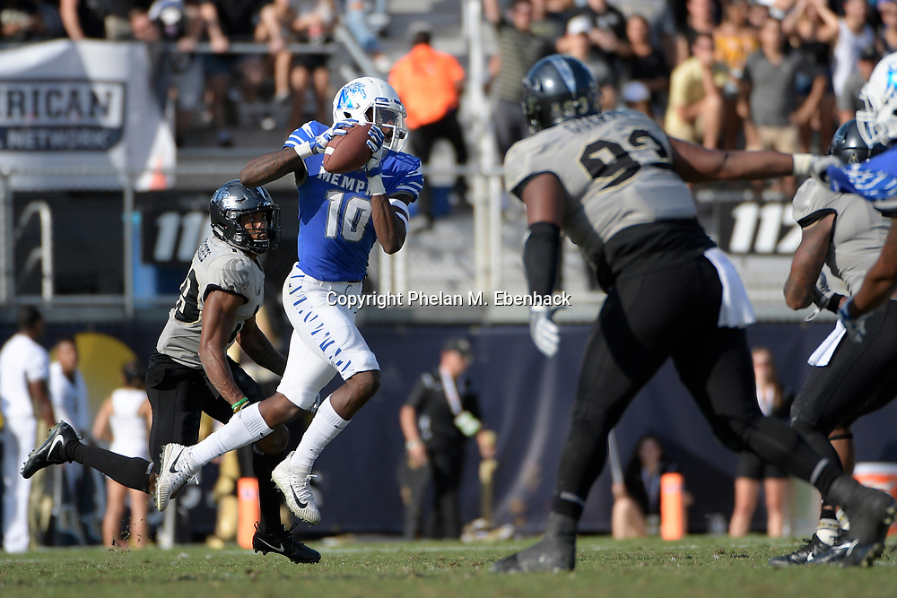 Memphis wide receiver Damonte Coxie (10) catches a pass in front of Central Florida defensive back Mike Hughes (19) during the second half of the American Athletic Conference championship NCAA college football game Saturday, Dec. 2, 2017, in Orlando, Fla. Central Florida won 62-55. (Photo by Phelan M. Ebenhack)