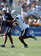 Dallas Cowboys wide receiver Rodney Smith (14) gives a straight arm as he runs with the ball after catching a pass during the second day of the Dallas Cowboys 2016 NFL training camp football practice held on Sunday, July 31, 2016 in Oxnard, Calif. (©Paul Anthony Spinelli)