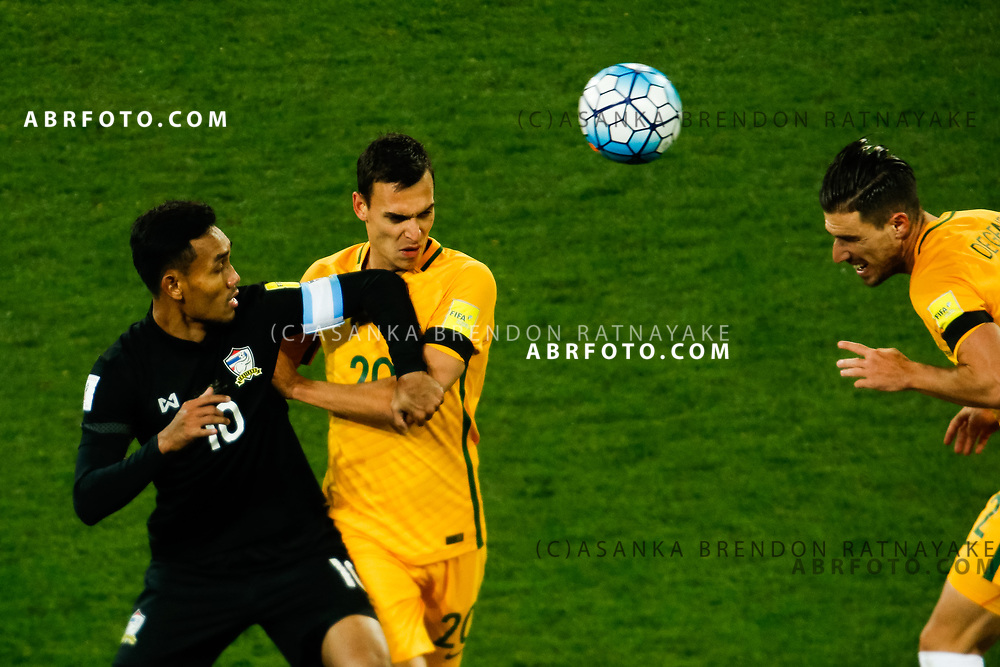 MELBOURNE, AUSTRALIA - SEPTEMBER 5 : Teerasil Dangda of Thailand Trent Sainsbury of the Australia Socceroos and Milos Degenek of the Australia Socceroos contest for the ball during the Stage 3 Group World Cup Football Qualifiers between Australia Vs Thailand at the Melbourne Rectangular Stadium, Melbourne, Australia 5 September 2017.