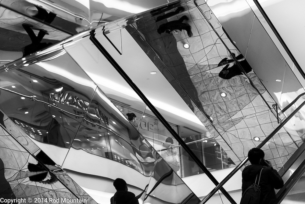 Abstract reflections from a mirrored escalator. Photo: © Rod Mountain