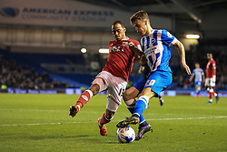 Brighton's Solly March passes under pressure from Bristol City's Elliott Bennett - Mandatory byline: Jason Brown/JMP - 07966 386802 - 20/10/2015 - FOOTBALL - American Express Community Stadium - Brighton,  England - Brighton & Hove Albion v Bristol City - Championship