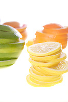 Sliced fruits on white background