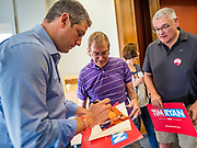 "01 JUNE 2019 - AMES, IOWA: Congressman TIM RYAN (D-OH) signs autographs after a campaign event in Ames Saturday. Ryan declared his candidacy for the US Presidency on the US television show ""The View"" on April 4. Ryan represents Ohio's 13th District, which includes Lordstown, where a large General Motors plant recently closed. Iowa traditionally hosts the the first election event of the presidential election cycle. The Iowa Caucuses will be on Feb. 3, 2020.              PHOTO BY JACK KURTZ"
