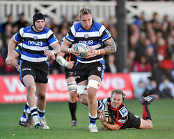 Dom Day (Bath) gets past the Dragons defence - Photo mandatory by-line: Patrick Khachfe/JMP - Tel: Mobile: 07966 386802 11/01/2014 - SPORT - RUGBY UNION -  Rodney Parade, Newport - Newport Gwent Dragons v Bath - Amlin Challenge Cup.