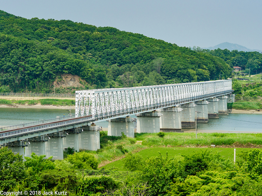 "09 JUNE 2018 - IMJINGAK, PAJU, SOUTH KOREA:  The ""Freedom Bridge"" from the South Korean side of the Korean DMZ in Imjingak. The bridge, now closed, is called the Freedom Bridge because it is the bridge POWs returning to the South crossed when they were releases by North Korea after the cease fire was signed. The Bridge could be reopened for train traffic if a peace treaty is signed with North Korea. Imjingak is a park and greenspace in South Korea that is farthest north most people can go without military authorization. The park is on the south bank of Imjin River, which separates South Korea from North Korea and is close the industrial park in Kaesong, North Korea that South and North Korea have jointly operated.    PHOTO BY JACK KURTZ"