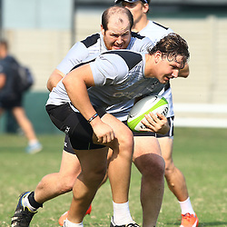 DURBAN, SOUTH AFRICA Thursday 16th July 2015 - Lourens Adriaanse with Etienne Oosthuizen during the Cell C Sharks training session at Growthpoint Kings Park in Durban, South Africa. (Photo by Steve Haag)
