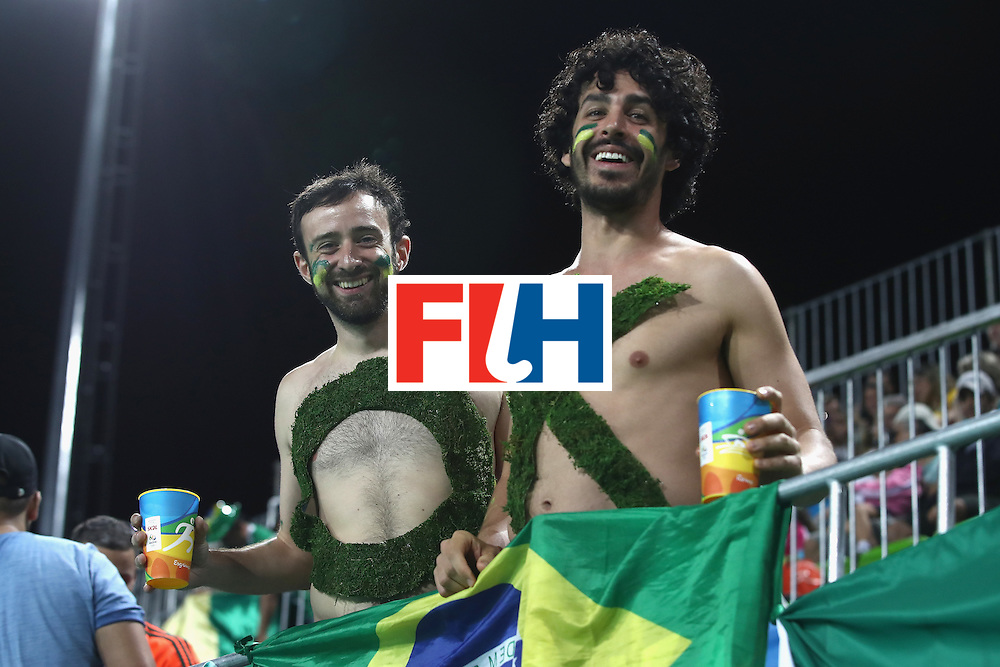 RIO DE JANEIRO, BRAZIL - AUGUST 07: Brazil supporters pose during the men's pool A match between Brazil and Belgium on Day 2 of the Rio 2016 Olympic Games at the Olympic Hockey Centre on August 7, 2016 in Rio de Janeiro, Brazil.  (Photo by Mark Kolbe/Getty Images)