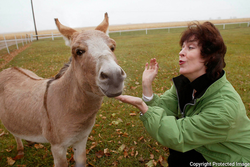 """Opera singer Jane Thorngren sings to her miniature donkey, Sebastian, on her family farm near Pilot Mound, Ia.   """"He's my sweetheart,"""" said Thorngren, of the four year-old family favorite.  """"My mom loved him, and he always greeted her in the morning.""""  Thorngren, an opera singer, has performed all over the world."""