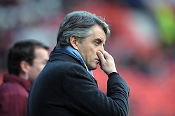 A dejected Roberto Mancini reflects during the Barclays Premier League match between Manchester United and Manchester City at Old Trafford on February 12, 2011 in Manchester, England.