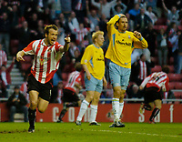 Photo. Jed Wee, Digitalsport<br /> NORWAY ONLY<br /> <br /> Sunderland v Crystal Palace, Nationwide League Division One Playoff Semi-finals Second Leg, 16/05/2004.<br /> Sunderland's Marcus Stewart (L) celebrates after scoring as Palace's Tony Popovic holds his head in his hands.