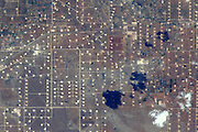 How aliens see us: Planet Earth, as viewed by International Space Station astronauts<br /> <br /> Tweeting from orbit has, it seems, become an important part of any self respecting astronaut's daily routine.<br /> But as these incredible images show, the results really are worth it. <br /> In a trend pioneered by Canadian ISS commander Chris Hadfield, new recruits are now tweeting regularly from orbit.<br /> Astronaut Reid Wiseman, who is currently aboard the station, is a prolific snapper, along with his German colleague Alexander Gerst. <br /> The pair have even developed their own styles, with Gerst preferring abstract patterns on the Earth's surface, while Wiseman favours storms and cities.<br /> Recently Gerst took part in a live Facebook Q&A to answer questions from people on Earth.<br /> One included Sir Richard Branson, who asked: 'What do you think the role of astronauts will be in 50 years' time? Pioneers? Guides? Or the norm?'<br /> Gerst responded: 'My hope would be that in 50 years from now, space travellers will not only be professional agency astronauts, but that everybody should have a realistic chance to make the incredible experience I am having right now.<br /> 'Anyway, I hope there will still be pioneers out there who will fly to destinations farther away.'<br /> <br /> Photo shows: Astronaut Alexander Gerst posted this photo to Facebook from the International Space Station on Aug. 19, 2014 with the caption, 'Oil fields near Midland, Texas.'<br /> ©Alexander Gerst/Exclusivepix