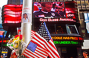 NEW YORK, NY: A poster for a person in the World Trade Center attack shares space with American flags on a light pole in Times Square in Manhattan, New York, during the memorial service for victims of the WTC attacks (simulcast on a Times Square jumbotron) Sept 23, 2001. A wave of patriotism swept New York and the US after terrorists crashed two hijacked jetliners into the World Trade Center collapsing the towers on Sept 11, 2001, killing more 2,900 people.   PHOTO BY JACK KURTZ