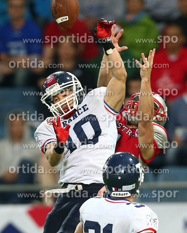 04.06.2014, UPC Arena, Graz, AUT, American Football Europameisterschaft 2014, Gruppe B, Frankreich (FRA) vs Oesterreich (AUT), im Bild Kevin  Yuan , (Team France, DB , #10) und Clemens Erlsbacher, (Team Austria, WR, #1) // during the American Football European Championship 2014 group B game between France vs Austria at the UPC Arena, Graz, Austria on 2014/06/04. EXPA Pictures © 2014, PhotoCredit: EXPA/ Thomas Haumer