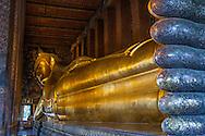 Reclining Gold Buddha statue at Wat Po, Bangkok, Thailand