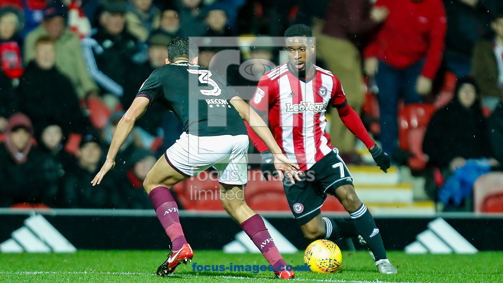 Florian Jozefzoon of Brentford takes on Neil Taylor of Aston Villa during the Sky Bet Championship match between Brentford and Aston Villa  at Griffin Park, London<br /> Picture by Mark D Fuller/Focus Images Ltd +44 7774 216216<br /> 26/12/2017