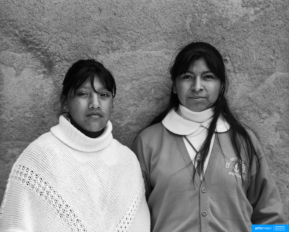 Unidentified Students. Potosi. Bolivia..Sitting at 4,090M (13,420 Feet) above sea level the small mining community of Potosi, Bolivia is one of the highest cities in the world by elevation and sits ?sky high? in the hills of the land locked nation. Overlooking the city is the infamous mountain, Cerro Rico (rich mountain), a mountain conceived to be made of silver ore. It was the major supplier of silver for the spanish empire and has been mined since 1546, according to records 45,000 tons of pure silver were mined from Cerro Rico between 1556 and 1783, 9000 tons of which went to the Spanish Monarchy. The mountain produced fabulous wealth and became one of the largest and wealthiest cities in Latin America. The Extraordinary riches of Potosi were featured in Maguel de Cervantes famous novel Don Quixote. One theory holds that the mint mark of Potosi, the letters PTSI superimposed on one another is the origin of the dollar sign. Today mainly zinc, lead, tin and small quantities of silver are extracted from the mine by over 100 co-operatives and private mining companies who still mine the mountain in poor working conditions, children are still used in the mines and the lack of protective equipment and constant inhalation of dust means miners have a short life expectancy with many contracting silicosis and dying around 40 years of age. UNESCO designated the historic city a World Heritage site in 1987. Most of Potosí's colonial churches have been restored, and tourism has increased. Potosi, Bolivia. 16th September 2011. Photo Tim Clayton