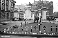 The annual Remembrance Sunday parade to the Belfast Cenotaph in the grounds of Belfast City Hall was an unintended victim of a N Ireland-wide parades ban. Wreaths were still laid but it was a very low-event compared with other years, 9th November 1969. 196911090260<br /> <br /> Copyright Image from Victor Patterson, 54 Dorchester Park, Belfast, UK, BT9 6RJ<br /> <br /> t1: +44 28 9066 1296 (from Rep of Ireland 048 9066 1296)<br /> t2: +44 28 9002 2446 (from Rep of Ireland 048 9002 2446)<br /> m: +44 7802 353836<br /> <br /> victorpatterson@me.com<br /> www.victorpatterson.com<br /> <br /> Please see my Terms and Conditions of Use at victorpatterson.com . It is IMPORTANT that you familiarise yourself with them.<br /> <br /> Images used on the Internet incur an additional cost and must be visibly watermarked i.e. ©Victor Patterson within the body of the image and copyright metadata must not be deleted. Images used on the Internet have a size restriction of 4kbs and are chargeable at rates available at victorpatterson.com.<br /> <br /> This image is only available for the use of the download recipient i.e. television station, newspaper, magazine, book publisher, etc, and must not be passed on to any third party. It is also downloaded on condition that each and every usage is notified within 7 days to victorpatterson@me.com<br /> <br /> The right of Victor Patterson to be identified as the author is asserted in accordance with The Copyright Designs And Patents Act (1988). All moral rights are asserted.