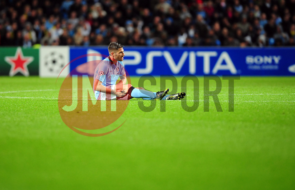 Manchester City's Javi Garcia sits injured - Photo mandatory by-line: Joe Meredith/JMP  - Tel: Mobile:07966 386802 03/10/2012 - Manchester City v Borussia Dortmund - SPORT - FOOTBALL - Champions League -  Manchester   - Etihad Stadium -