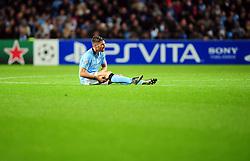 Manchester City's Javi Garcia sits injured - Photo mandatory by-line: Joe Meredith/JMP  - Tel: Mobile:07966 386802 03/10/2012 - Manchester City v Borussia Dortmund - SPORT - FOOTBALL - Champions League -  Manchester   - Etihad Stadium -