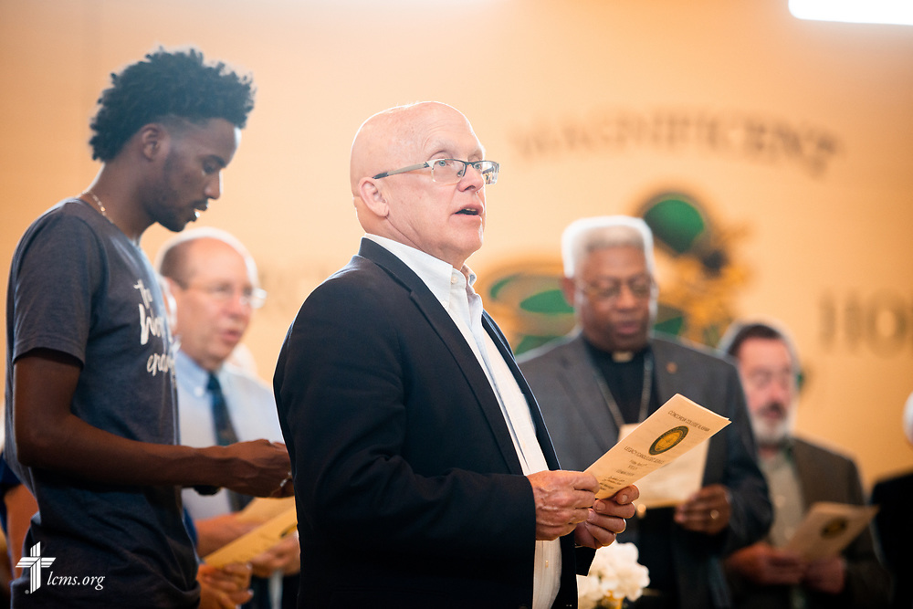 A Board of Regents member stands during the Legacy/Candlelight service on Friday, April 27, 2018, in the Lehman Center at Concordia College Alabama in Selma, Ala. LCMS Communications/Erik M. Lunsford