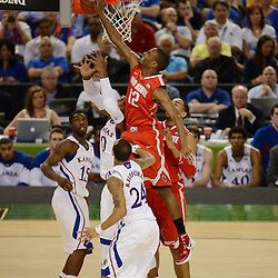 Mar 31, 2012; New Orleans, LA, USA; Ohio State Buckeyes forward Sam Thompson (12) blocks the shot by Kansas Jayhawks forward Thomas Robinson (0) and guard Elijah Johnson (15) and guard Travis Releford (24) look on during the first half in the semifinals of the 2012 NCAA men's basketball Final Four at the Mercedes-Benz Superdome. Mandatory Credit: Derick E. Hingle-US PRESSWIRE