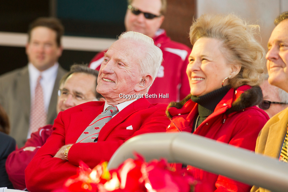 Nov 23, 2012; Fayetteville, AR, USA; Former Arkansas Razorbacks  coach and athletic director Frank Broyler and his wife Guendaline Whitehead Broyles laugh during a dedication ceremony before the start of a game against the Louisiana State Tigers at Donald W. Reynolds Stadium.  A seven and a half foot statue weighing more than 700 pounds was dedicated to Frank Broyles who served the University of Arkansas for more than 50 years in his career. Mandatory Credit: Beth Hall-US PRESSWIRE