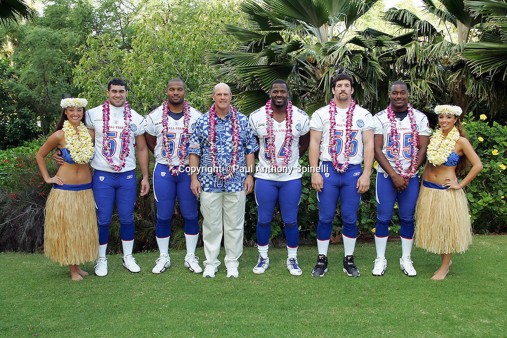KAPOLEI - FEBRUARY 10:  The National Football Conference NFC All-Star linebackers pose with their position coach and hula girls at the 2006 NFL Pro Bowl at the Ko Olina Resort on February 10, 2006 in Kapolei, Hawaii. ©Paul Spinelli/SpinPhotos