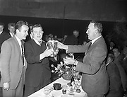 14/04/1962<br /> 04/14/1962<br /> 14 April 1962<br /> Jacob's Presentation.<br /> Cup being presented to winning team of the match between Jacob's Of Dublin and Jacob's of Liverpool at Jacob's Reception Hall, Dublin.