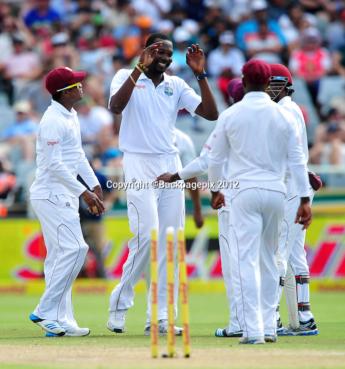 West Indian players celebrate after Sulieman Benn gets the wicket of Faf du Plessis of South Africa during day 2 of the Sunfoil Test Series 2014/15 game between South Africa and the West Indies at Newlands Stadium, Cape Town on 3 January 2015 ©Ryan Wilkisky/BackpagePix