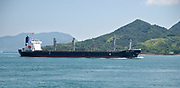 A freighter passing Okunoshima in Hiroshima Prefecture Japan.