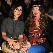 PARIS, FRANCE - MARCH 06:  Sylvie Hoarau and Aurelie Saada of the Brigitte Band attend the Paco Rabanne Ready-To-Wear Fall/Winter 2012 show as part of Paris Fashion Week at Espace Pierre Cardin-Grand Palais on March 6, 2012 in Paris, France.  (Photo by Tony Barson/WireImage)