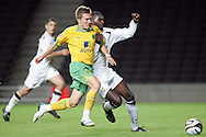 Milton Keynes - Tuesday, August 12th, 2008: Jude Stirling (R) of MK Dons and Arturo Lupoli (L) of Norwich City during the Carling League Cup First Round match at Stadium MK, Milton keynes. (Pic by Mark Chapman/Focus Images)