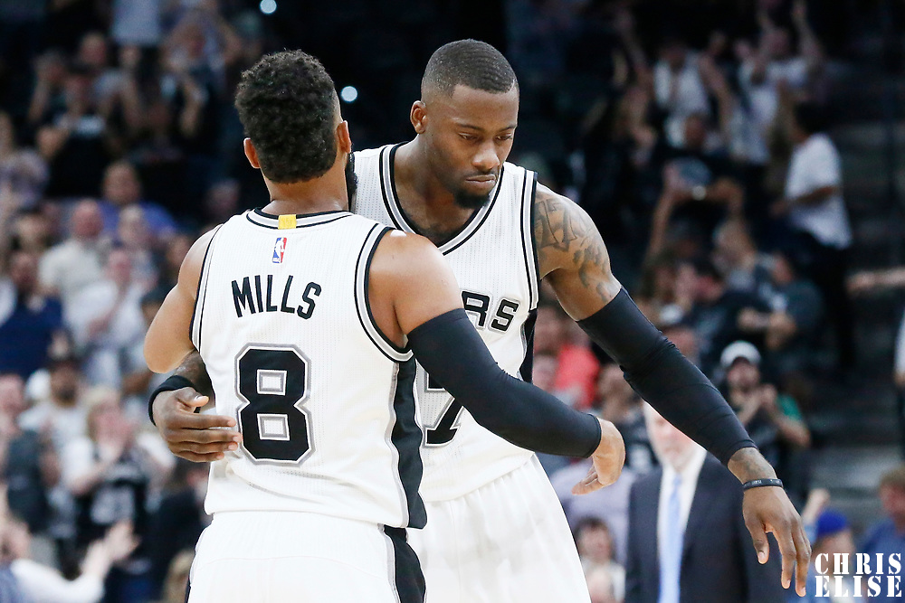 04 April 2017: San Antonio Spurs guard Jonathon Simmons (17) congratulates San Antonio Spurs guard Patty Mills (8) during the San Antonio Spurs 95-89 OT victory over the Memphis Grizzlies, at the AT&T Center, San Antonio, Texas, USA.