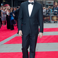 on the red carpet of the Olivier Awards 2013 at the Royal Opera House.
