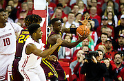 Center Bakary Konaté comes up with a rebound during the second half of the University of Minnesota Men's Basketball game versus University of Wisconsin on March 5, 2017.