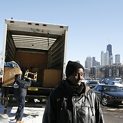 Long time Cabrini Green resident Annie Ricks watches as some of her belongs are loaded on a truck December 7, 2010. Ricks was the last family to reside in the Chicago Public Housing Authority's public housing development. Ricks and her family moved from the public housing Thursday December 9, 2010. <br /> Photography by Jose More