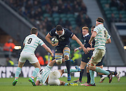 Twickenham, United Kingdom.  Nic ROBERTS-HUNTLEY, jumps over the Cambridge Players as he runs, during the, during the  Men's Varsity Rugby, [Oxford vs Cambridge],Twickenham. UK, at the RFU Stadium, Twickenham, England, <br /> <br /> Thursday  08/12/2016<br /> <br /> [Mandatory Credit; Peter Spurrier/Intersport-images]