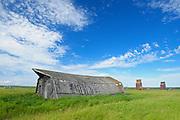 Roof of old barn rand old grain elevators<br /> Neidpath<br /> Saskatchewan<br /> Canada